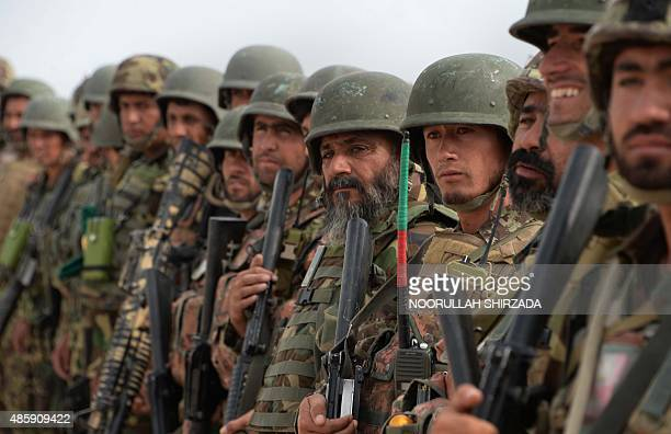Afghan security personnel gather to leave the Khogyani district after a month long antiTaliban operation in various parts of eastern Nangarhar...