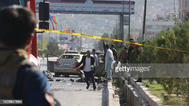 Afghan security personnel inspect a site following a suicide attack in Kabul on September 9 2018 A suicide bomber on a motorbike blew himself up near...