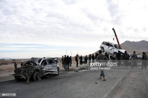 Afghan security personnel inspect after a suicide car bomb attack on December 17 2017 A suicide car bomb attack targeting NATO forces in neighbouring...