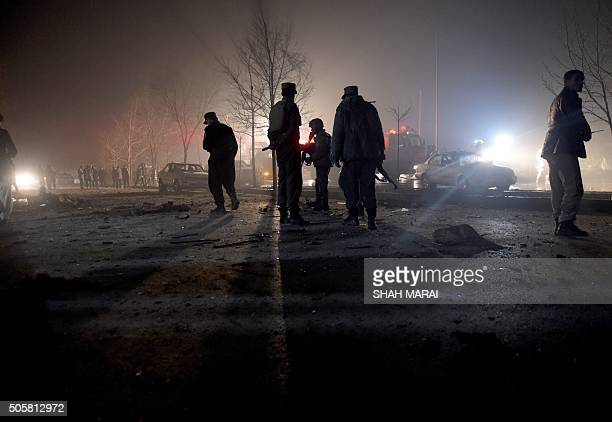 Afghan security personnel inspect the area near the site of an attack by a suicide bomber against a vehicle carrying employees of popular Afghan TV...