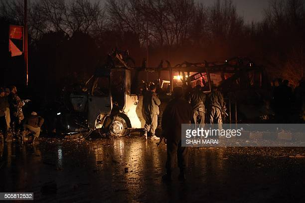 Afghan security personnel inspect the damaged vehicle carrying employees of popular Afghan TV channel TOLO in Kabul on January 20 following an attack...