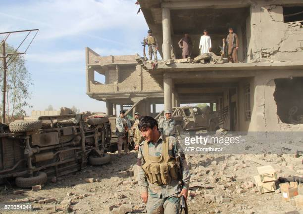 Afghan security personnel inspect the site of a suicide attack in Lashkar Gah capital of Helmand province on November 10 2017 A suicide bomber on...