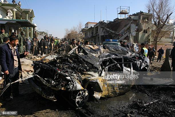 Afghan security personnel inspect the site of a suicide attack near a guesthouse on December 15 2009 in Kabul Afghanistan A suicide attack near a...