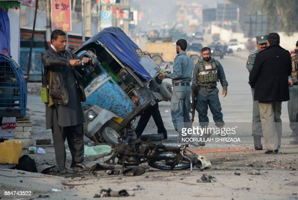 Afghan security personnel inspect the site of suicide attack in Jalalabad on December 3 2017 At least six people were killed after a suicide bomber...