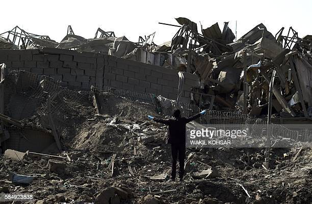 Afghan security personnel investigate the site after a powerful truck bomb targeting a hotel used by foreign contractors exploded on the outskirts of...