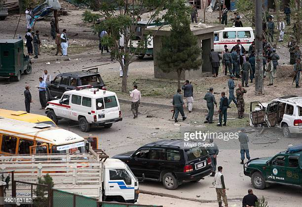 Afghan security personnel investigate the site of a suicide attack that struck the convoy of presidential candidate Abdullah Abdullah on June 6 2014...