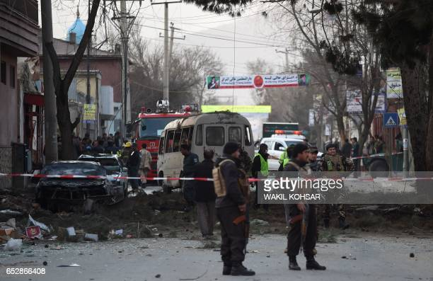 Afghan security personnel investigate the site of an explosion in Kabul on March 13 2017 A powerful explosion struck a bus in downtown Kabul during...