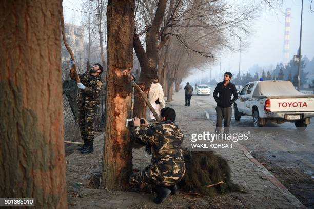 Afghan security personnel investigate the site of the January 4 suicide attack in Kabul on January 5 2018 A suicide attacker blew himself up near a...