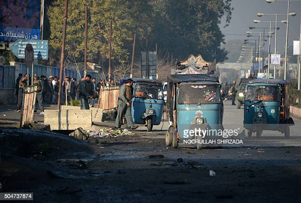 TOPSHOT Afghan security personnel keep watch along a street after an attack from a building close to the Pakistan consulate in Jalalabad on January...