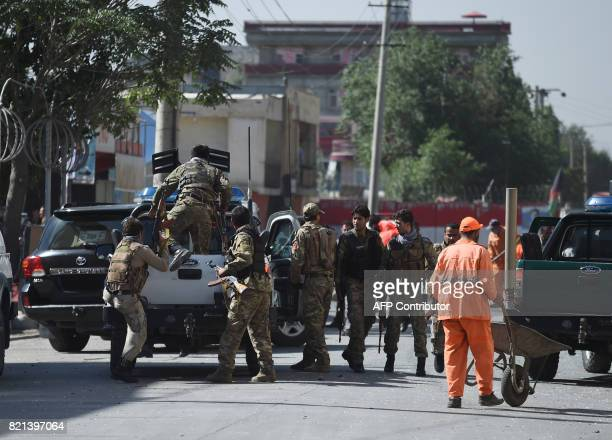 Afghan security personnel leave the site of a car bomb attack in western Kabul on July 24 2017 At least 24 people have been killed and 42 wounded...