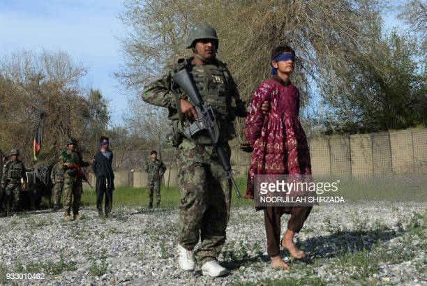 Afghan security personnel present to the media two Taliban fighters one of them dressed as a woman at the Afghan National Army headquarters in...