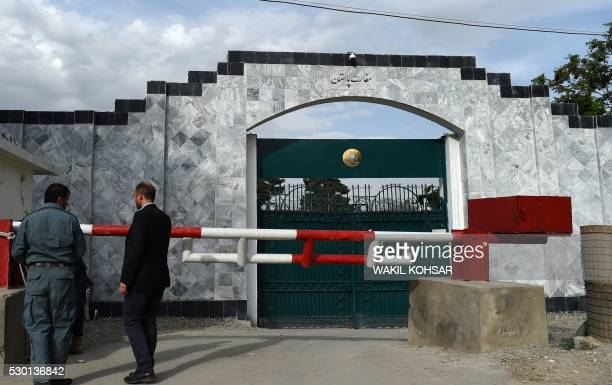 Afghan security personnel stand guard in front of the Pakistan embassy in Kabul on May 10 2016 US and Afghan forces freed the kidnapped son of a...