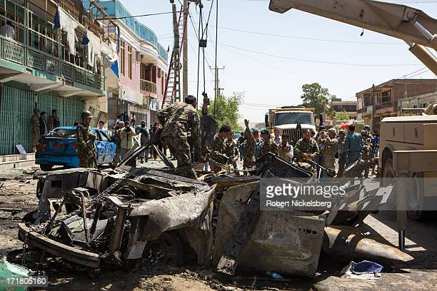Afghan security personnel use a rescue vehicle to remove an American-made SUV destroyed by a suicide car bomber May 16, 2013 in Kabul, Afghanistan....