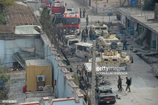 Afghan security personnels gather near an office of the British charity Save the Children after an attack in Jalalabad on January 24 2018 Gunmen...