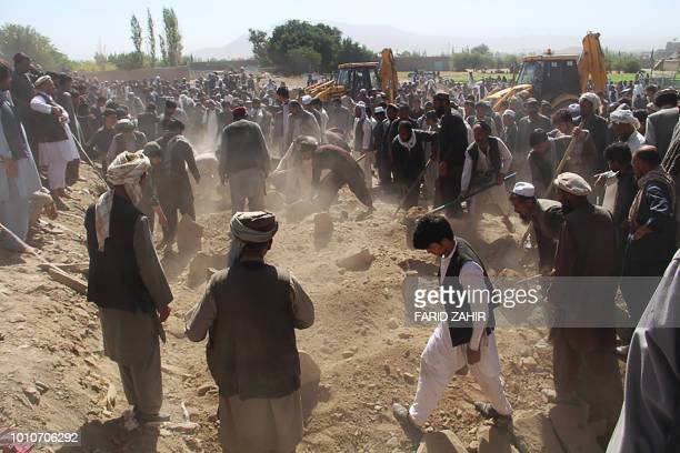 Afghan Shiite mourners cover the grave with soil after funeral prayers of 35 victims of a suicide attack in a Shiite mosque in Gardez of Paktia...