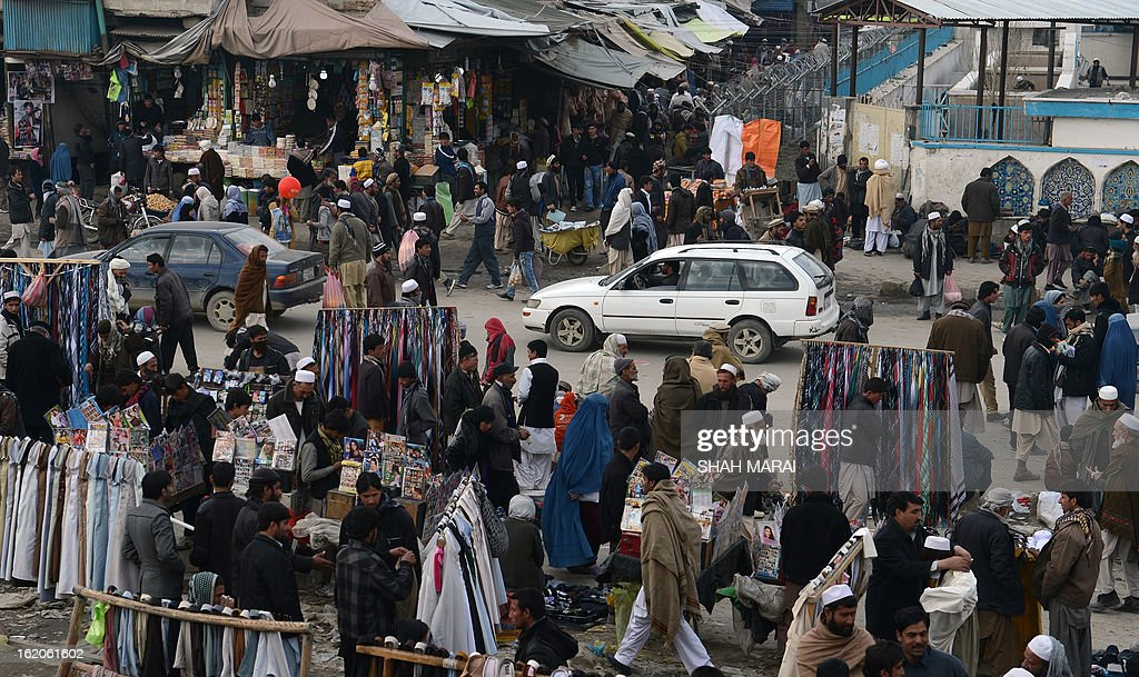Afghan shoppers throng the Mandave main market in downtown Kabul on February 19, 2013. Insurgent attacks on Afghan government employees soared by 700 percent last year even as the overall 2012 civilian death toll from the war fell for the first time in six years, the UN said on February 19. Targeted killings of women in government service by Taliban-led insurgents were 'particularly disturbing', the UN mission in Afghanistan said in its annual report on civilian casualties. AFP PHOTO/ SHAH Marai