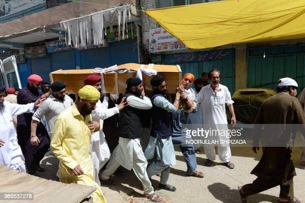 Afghan Sikhs carry the coffin of one of the 19 victims of a suicide attack in Jalalabad on July 2 a day after the attack Grief mixed with anger among...