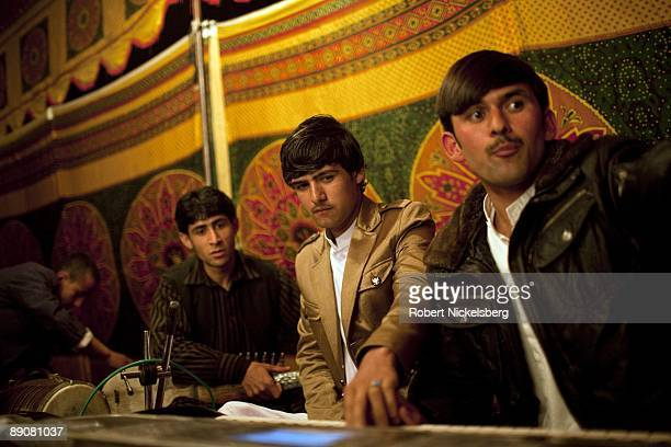 Afghan singer Mirwais Najrabi 17 years center tunes up with his 4 piece band before a performance at a groom's wedding party on April 16 2009 in...