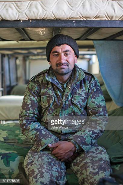 afghan soldier sitting in barracks, afghanistan - jake warga stock pictures, royalty-free photos & images