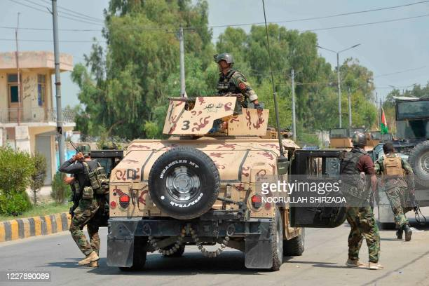 Afghan soldiers arrives with their Humvee vehicle outside a prison during an ongoing raid in Jalalabad on August 3, 2020. - At least 20 people have...