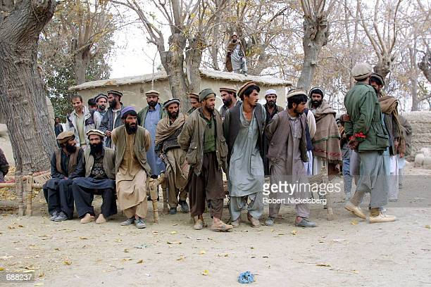 Afghan soldiers display foreign prisoners from the Al Qaeda bases in the Tora Bora region to the public following their capture in the last...