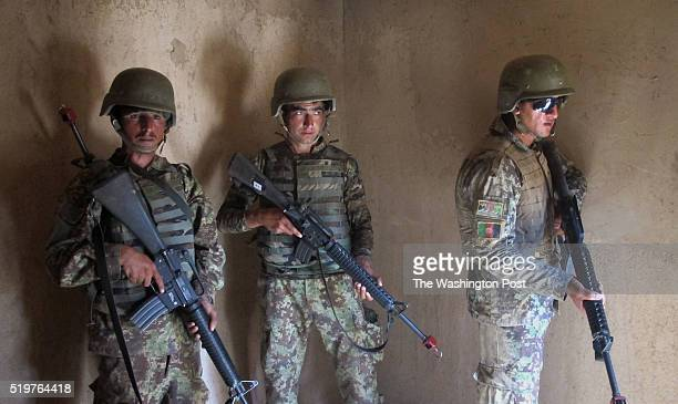 Afghan soldiers from the 215th Corps practice storming a compound during a training exercise on April 6 2016 at Camp Shorback Afghanistan