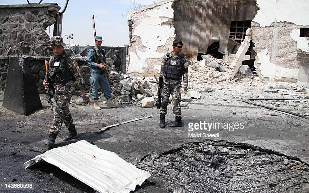 Afghan soldiers inspect the scene of a suicide bomb attack on 02 May 2012 in Kabul Afghanista A suicide bomber detonated his vehicle packed with...