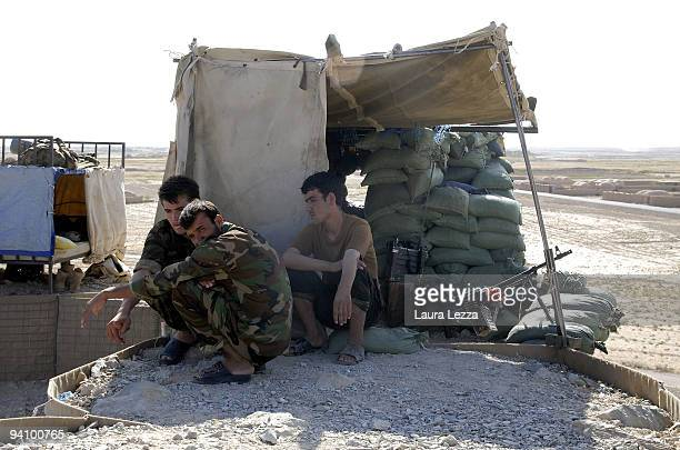 Afghan Soldiers of ANA in a check point outside the Highway 517 while Italian soldiers of the Folgore Parachute Brigade and Brigata Bersaglieri...