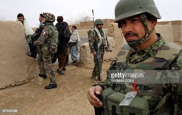 Afghan soldiers patrol jointly with British soldiers of the 1st batallion of the Royal Welsh French soldiers of the 21st RIMA in a street of Showal...