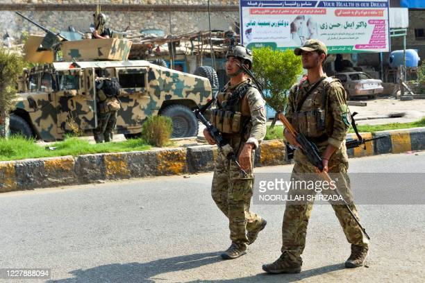 Afghan soldiers patrol outside a prison during an ongoing raid in Jalalabad on August 3, 2020. - Afghan authorities on August 3 deployed more...