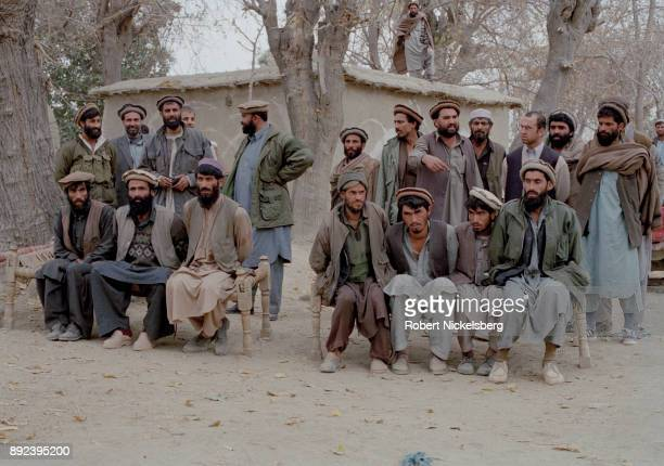 Afghan soldiers present Afghan fighters belonging to or fighting for Al Qaeda that were caught in the battle around the Tora Bora region December 17...