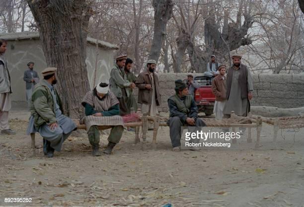 Afghan soldiers present three Arab fighters belonging to Al Qaeda that were caught in the battle around the Tora Bora region December 17 2001 in Agom...