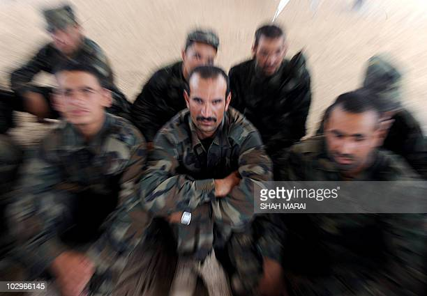 Afghan soldiers sit during lessons as part of combat training at the Afghan National Army training camp on the outskirts of Kandahar on July 13 2010...