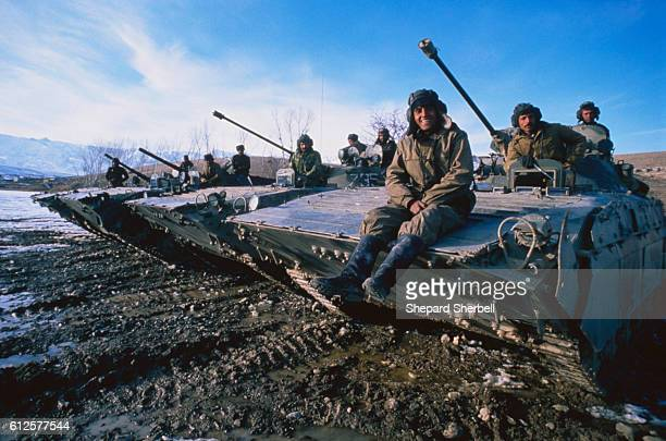 Afghan Soldiers Sitting on Armored Military Vehicles