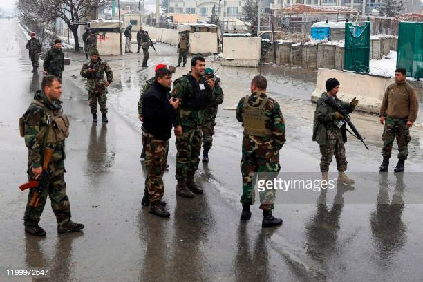 Afghan soliders gather on a road following a suicide attack near the Marshal Fahim Military Academy base in Kabul on February 11 2020 A suicide...