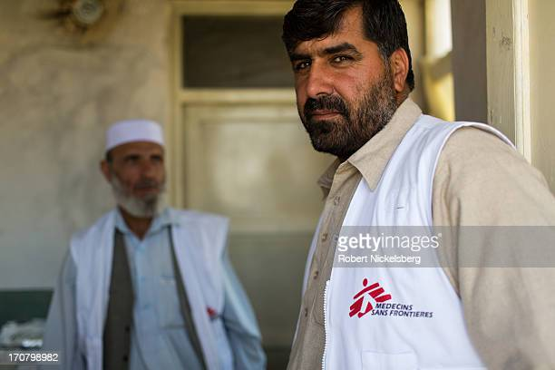 Afghan staff of Doctors Without Borders wait for local male residents to arrive for vaccinations at a government clinic May 14 2013 on the eastern...