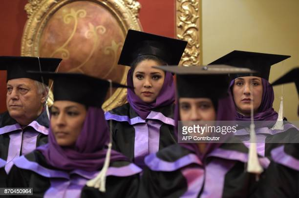 Afghan students attend the graduation ceremony of the firstever class of Gender and Womens studies master's programme in Kabul on November 5 2017...