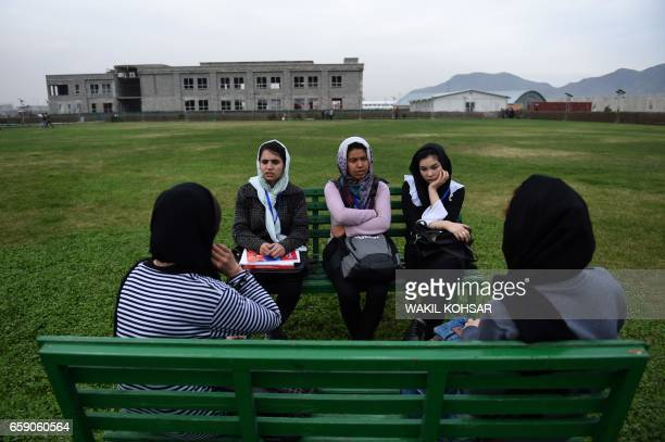TOPSHOT Afghan students from the American University of Afghanistan wait for the start of classes at the beginning of a new term in Kabul on March 28...