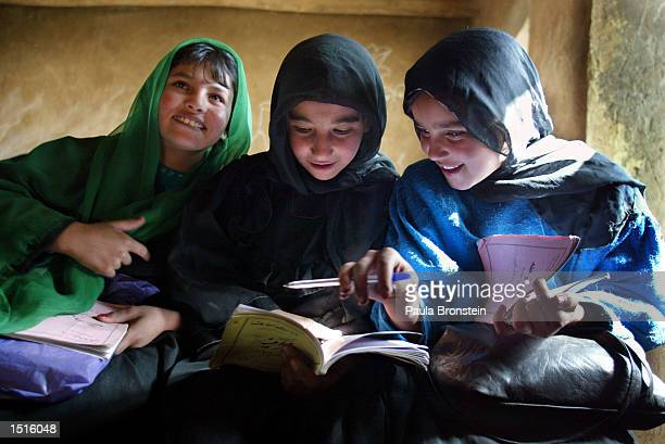 Afghan students from the Chagcharan girls school study together during class October 22 2002 in Chagcharan located in central western Afghanistan At...