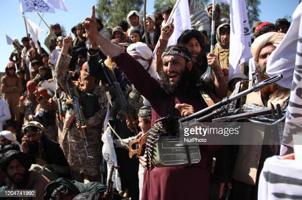 Afghan Taliban fighters and villagers attend a gathering as they celebrate the peace deal signed between US and Taliban in Laghman Province, Alingar...