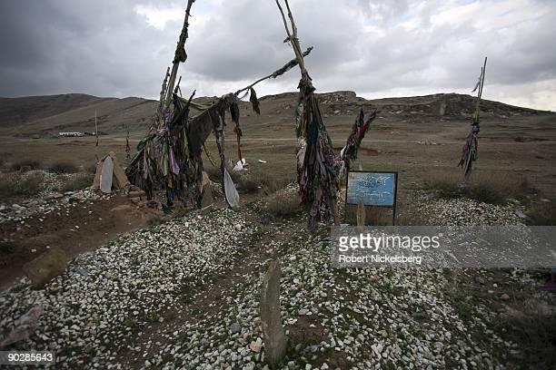 Afghan taliban fighters lie in graves on April 2 2009 in Deh Sabs village north of Kabul Afghanistan Most of the several hundred buried afghan...