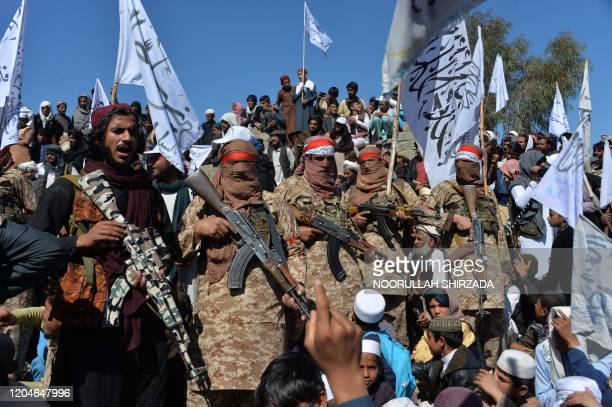 TOPSHOT Afghan Taliban militants and villagers attend a gathering as they celebrate the peace deal and their victory in the Afghan conflict on US in...
