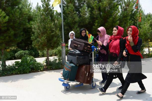 Afghan teenagers from Afghanistan Robotic House walk towards Herat International Airport on July 13 before embarking for the United States A team of...