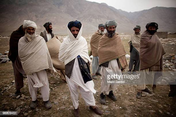 Afghan tribesmen from the Pashtun ethnic minority stand at the location of a future mosque in an area south of Kabul on May 2 2010 in Afghanistan...