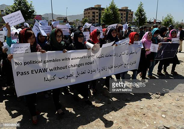Afghan university students and independent civil society activists take part in a demonstration in support of passing the Elimination of Violence...
