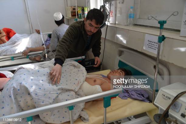 Afghan victims receive medical treatment at a hospital following a suicide attack on a private construction company in Jalalabad on March 6 2019 At...