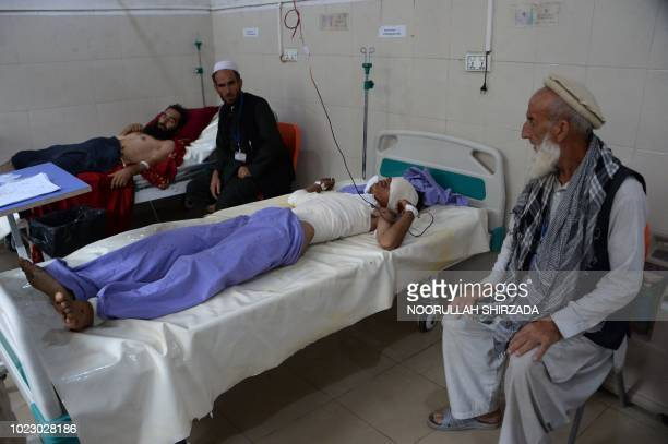 Afghan victims receive treatment at a hospital following a suicide attack in Jalalabad on August 25 2018 A suicide bomb blast killed at least two...