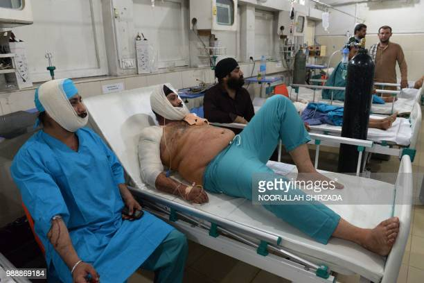Afghan victims receive treatments at an hospital following a suicide attack in Jalalabad on July 1 2018 An explosion in a city in eastern Afghanistan...