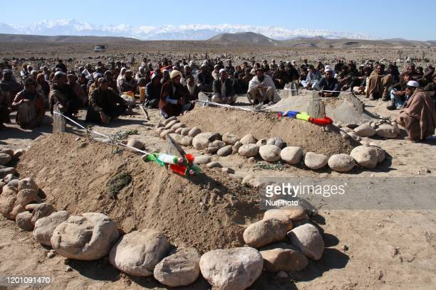 Afghan villagers gather during burial ceremony of an Airstrike on civilians vehicle in Sorkh-Rod District, of Nangarhar, Province, Afghanistan on...
