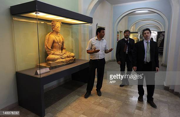 Afghan visitors looks at part of the historical collection at the Kabul National Museum in Kabul on May 28 2012 About 70 percent of the museum's...